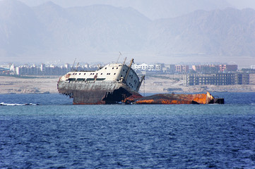 Abandoned and rusty shipwreck