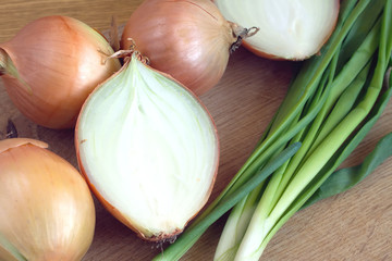Ripe onion bulbs and chives closeup