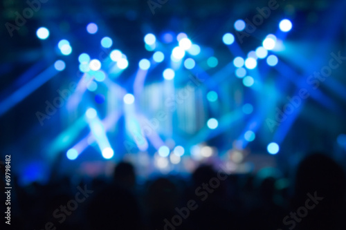 Defocused crowd on a concert. - 69798482
