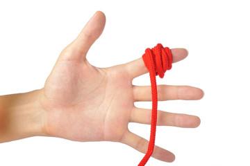 人間の手に結ばれた赤い糸
