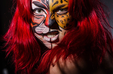 Woman with tiger face in halloween concept