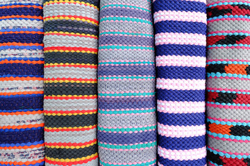 carpet background or texture with stripes in many colors