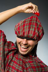 Funny scotsman in traditional clothing