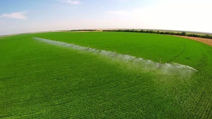 aerial Irrigation system on a industrial farm. Irrigating beans