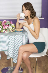 Attractive Young Woman Having Breakfast Drinking Coffee