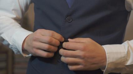 man wears a vest
