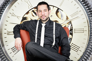 handsome business man against watch background