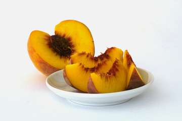 peach in white plate