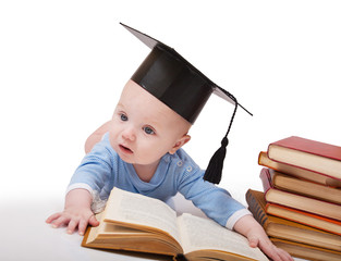 Baby in a hat of the bachelor and the book