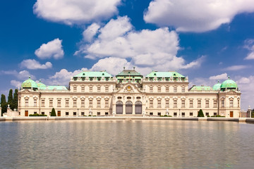 Belvedere palace is reflected in fountain water, Vienna, Austria