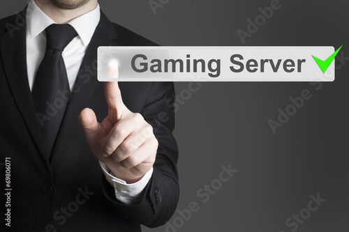 businessman pushing button gaming server checked Poster