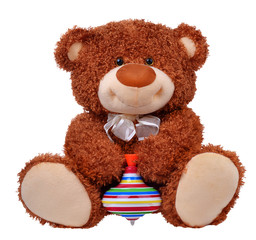 Brown teddy bear with the top in its hands