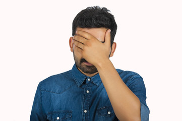 Disappointed Man Covering Face With Hand