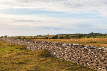 High stone wall in sunset