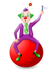 Funny clown over ball