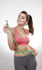 woman measuring abdomen