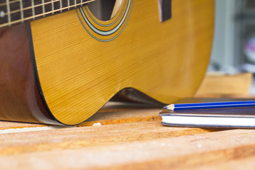 acoustic guitar and create note book select focus