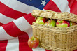 apples in basket on American flag