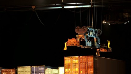 Container is moved by a crane