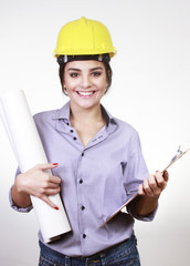 Beautiful woman architect with helmet with clipboard