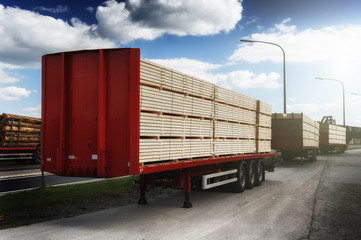Trucks charged with wood planks