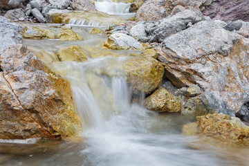 Alps beck under the Hochkonig peak in the calcite rock - Austria