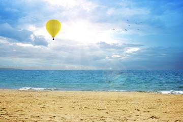 An air balloon flying on the ocean