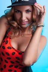 Seductive adult girl on blue background