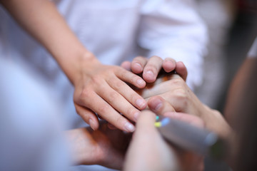 Healthcare workers demonstrating unity; teamwork concept