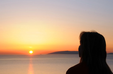 Woman's Silhouette at Sunrise