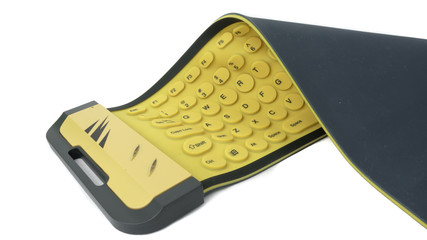 Flexible rubber computer keyboard isolated on white background