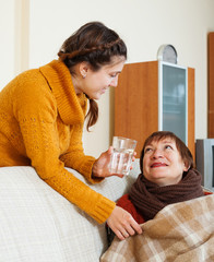 daughter caring for unwell mother