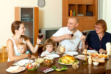 Portrait of happy family together over dining table