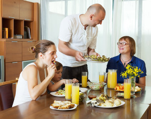 multigeneration family  eating at home