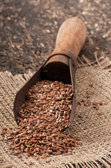 old measuring scoop with flax seeds