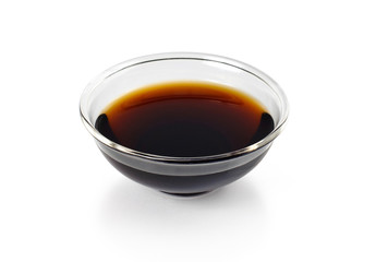 Soy sauce in bowl on white background
