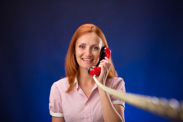 Redhead woman with telephone