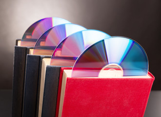 Cd disks are sticks out from red book
