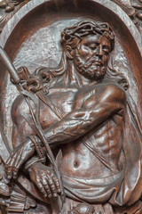 Bruges - carved relief of Jesus in the bond in Carmelites church