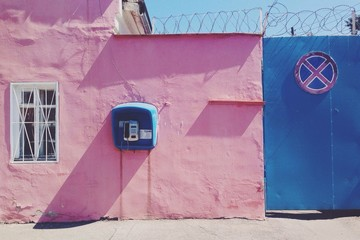 pink wall with telephone