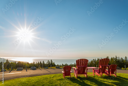 Leinwanddruck Bild Red chairs from Butland lookoff  with a beautiful view of Fundy