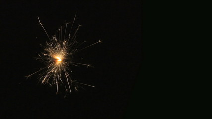 Fuse/sparkler burning on black background