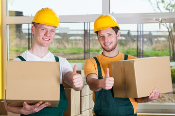 Storekeepers showing thumbs up sign