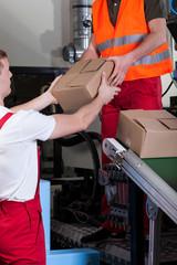 Men during work at distribution warehouse