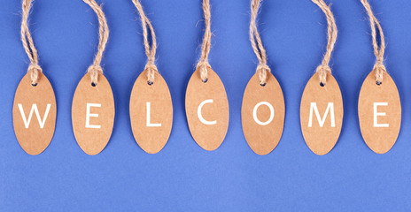 Welcome tags on blue background