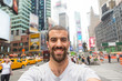 Young Man Taking Selfie in Times Square