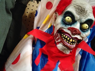 Scary Halloween clown on sale at store.