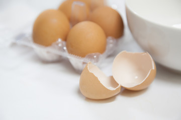 Egg shells with white bowl and carton