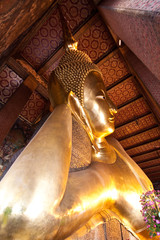 Half view of reclining buddha in Wat Pho