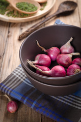 Shallots in a bowl with the food preparation table